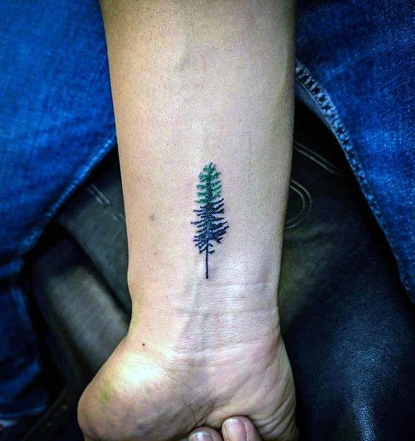 Cool Quarter Sized Black And Green Ink Pine Tree Wrist Tattoo Design Ideas For Male