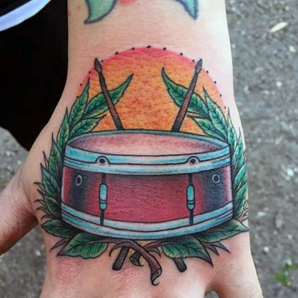 Cool Rising Sun Olive Branch Male Drum Tattoo On Hand