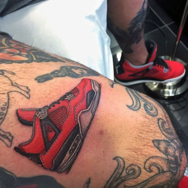 Cool Running Sneaker Shoe Tattoo On Mans Thigh