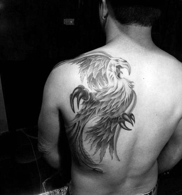 Cool Shoulder Blade And Back Phoenix Guys Tattoo Designs