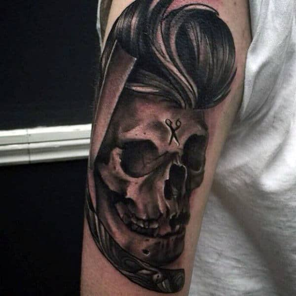 Cool Skull With Head Of Hair Tattoo On Mans Arm