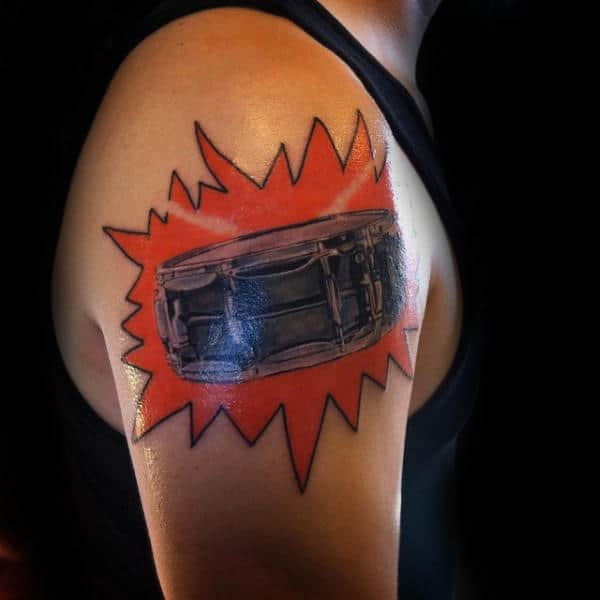 Cool Snare Drum Upper Arm Male Tattoo With Orange Ink Background