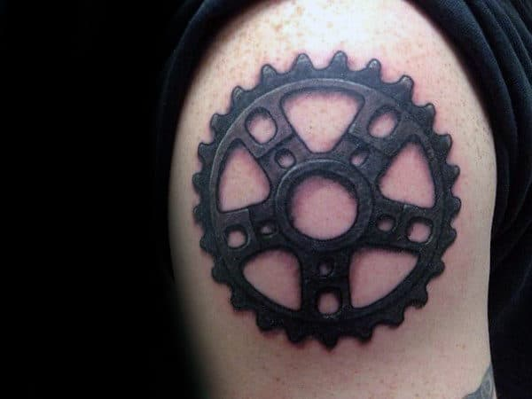 Cool Sprocket Upper Arm Tattoo For Men