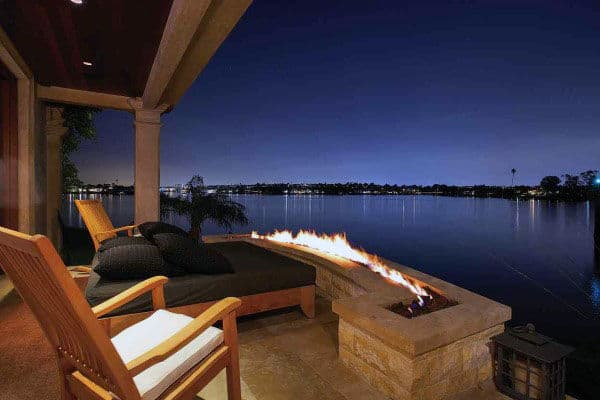 Cool Stone Fireplace With Lake View At Night