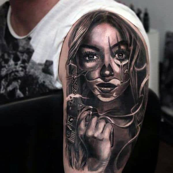 Cool Tattoo Of A Girl With Revolver Tattoo Upper Arms