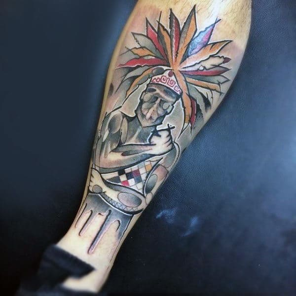 Cool Tattoo Of Red Indian With Large Feathers On Lower Legs