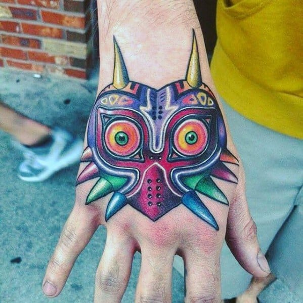 Cool The Legend Of Zelda Male Hand Majoras Mask Tattoo Designs