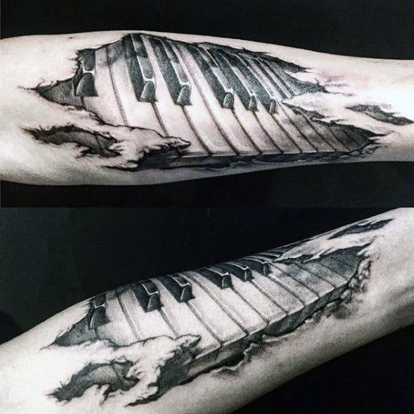 Cool Torn Skin Male Forearm Tattoo Of Piano Keys