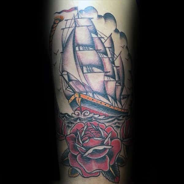 Cool Traditional Rose With Sailing Ship Male Forearm Tattoo Design Ideas