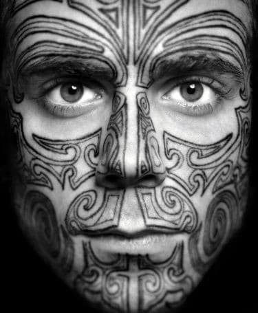 Cool Tribal Patterned Male Face Tattoo Design Ideas