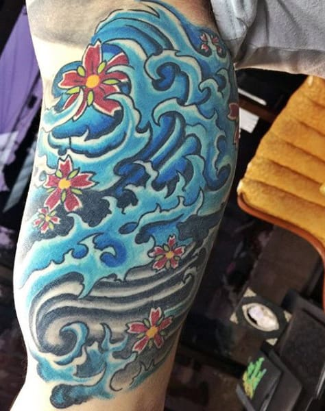 Cool Water Wave Tattoos For Guys On Bicep