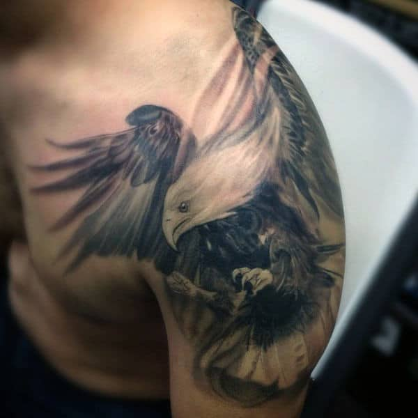 Cool Windswept Hawk Tattoo On Gentleman Shoulder