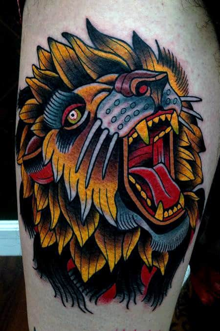 Cool Yellow Growling Traditional Lion Mens Thigh Tattoos