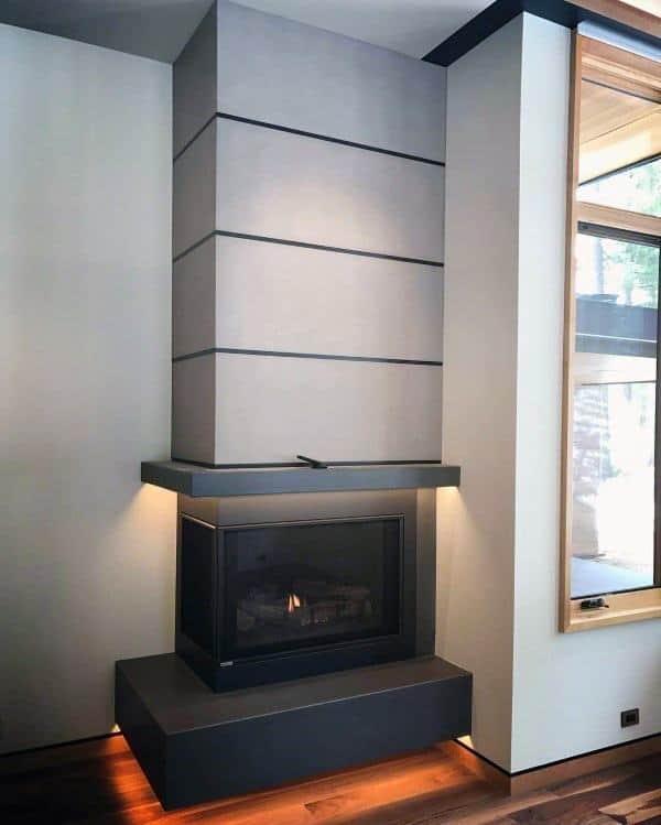 Corner Concrete Fireplace Design