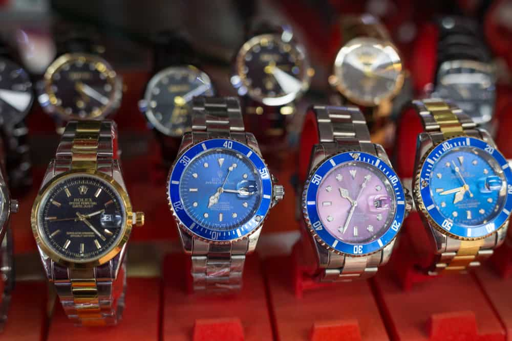 counterfeit rolex watches on sale at a local street market in phnom penh, cambodia