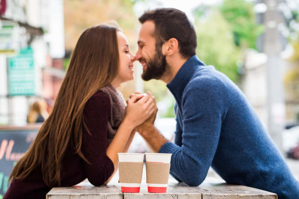 couple drinking coffee outdoor