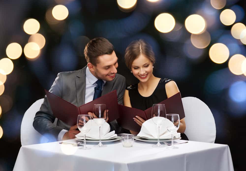 couple looking restaurant menus