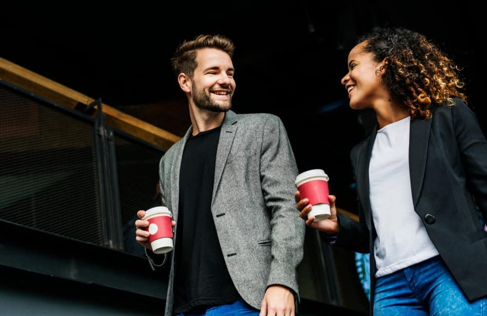 couple having take away coffee