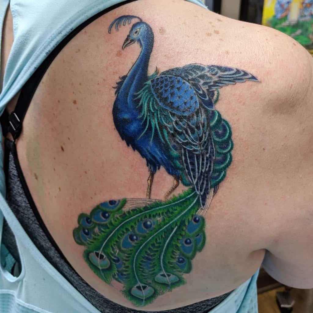 Couvrir le tatouage de paon