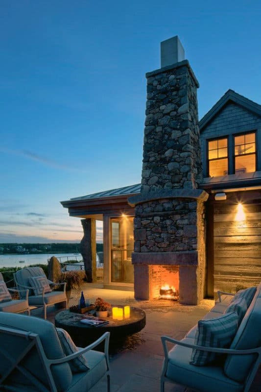 Cozy Outdoor Fireplace On Side Of Home