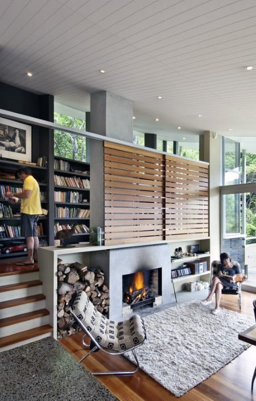 Creative Home Library With Fireplace And Small Stairs