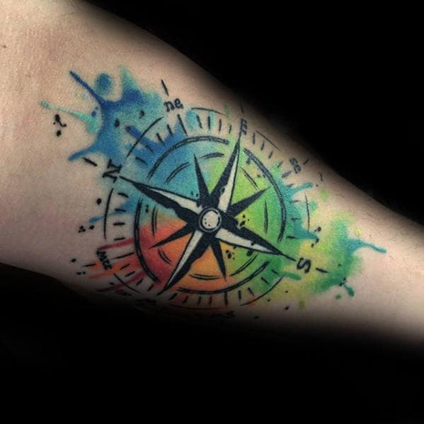 Creative Inner Forearm Tattoo Of Watercolor Compass On Man
