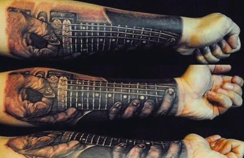 Creative Men's Guitar Tattoos