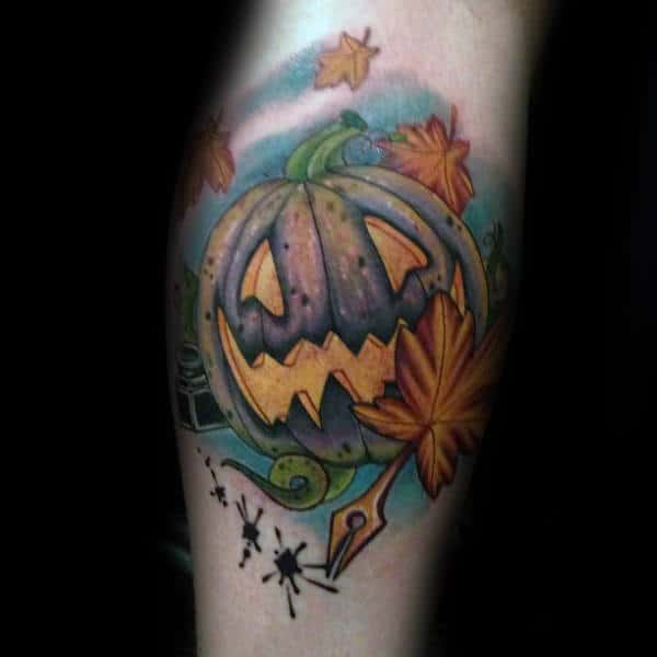 Creative Pumpkin With Fall Leaves Blowing In The Wind Tattoo For Men On Arm