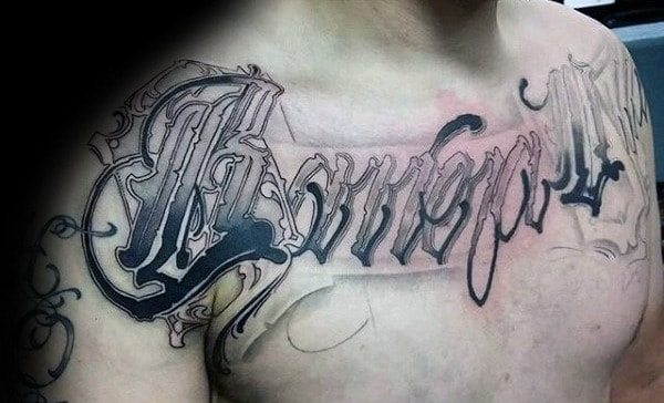 Creative Script Last Name Lettering Guys Chest Tattoos