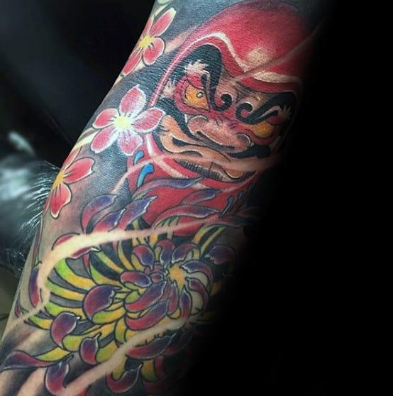 Creative Sleeve Tattoo Of Daruma Doll Floral Design For Men