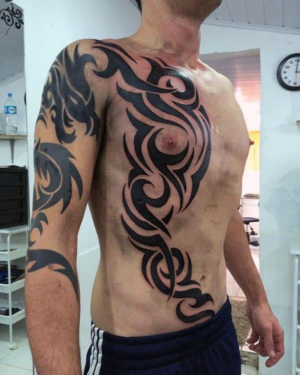 Creative Traditional Guys Tribal Rib Cage Side Tattoos