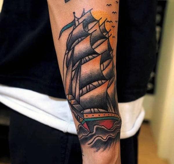 Creative Traditional Sailboat Wrist Tattoo On Man