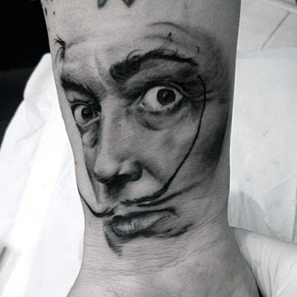 Creative Wrist Portrait Of Salvador Dali Tattoos For Men
