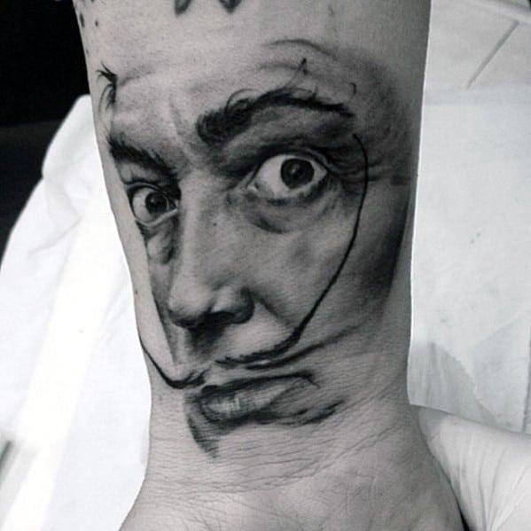 Creative Wrist Portrait Of Salvador Dali Tattoos For Men