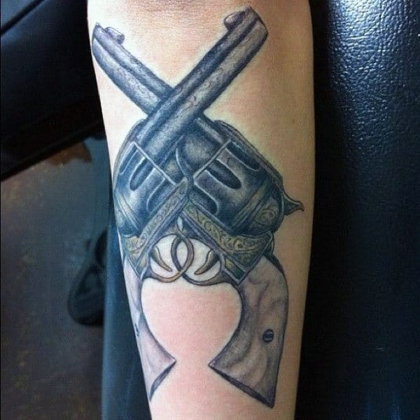 Criss Crossed Pistol Tattoo On Forearms Men