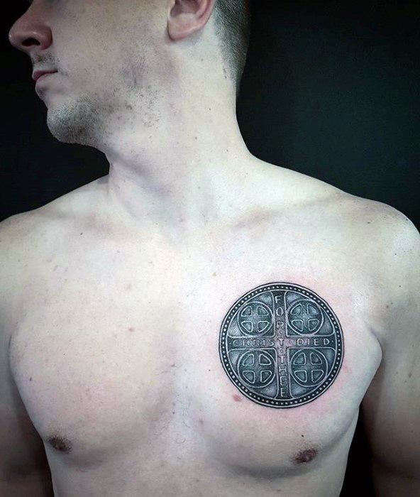 cross-circle-small-guys-chest-tattoo