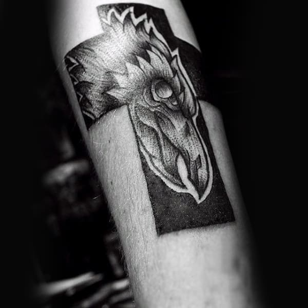 Cross With Crow Design Male Tattoo On Forearm