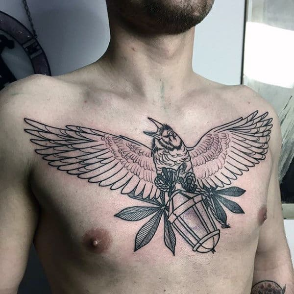 Crow Flying With Lantern Upper Chest Tattoos For Males