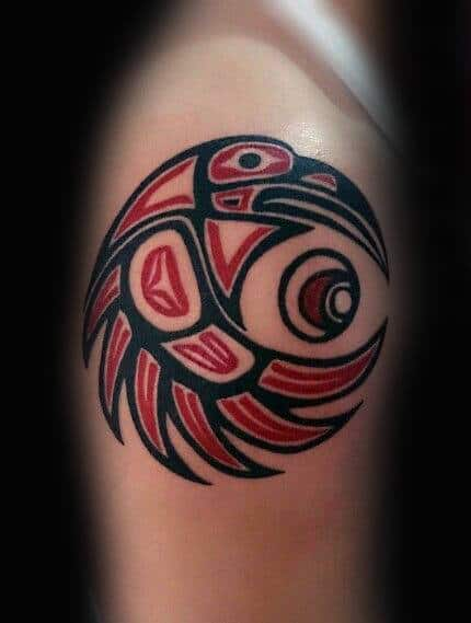 Curled Up Haida Bird Tattoo Male Arms