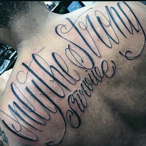 Cursive Only The Strong Survive Mens Upper Back Lettering Tattoos