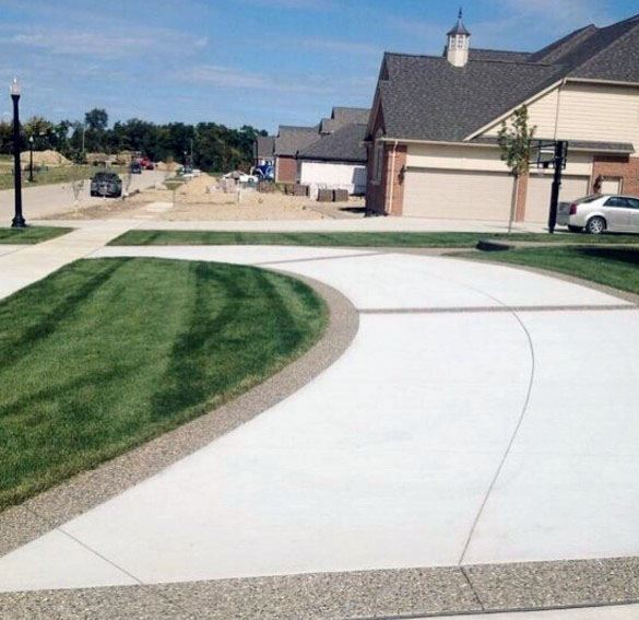 Curved Concrete Driveway Cool Front Yard Ideas