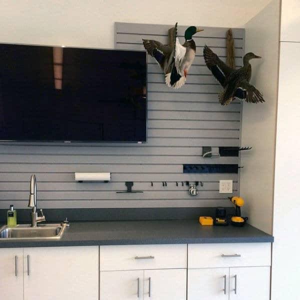 Custom Garage Design With Slat Wall For Storage