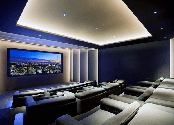 Custom Home Theater With Lots Of Grey Seating