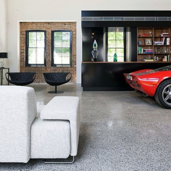 Custom Lounge Area With Garage Storage Bookcases
