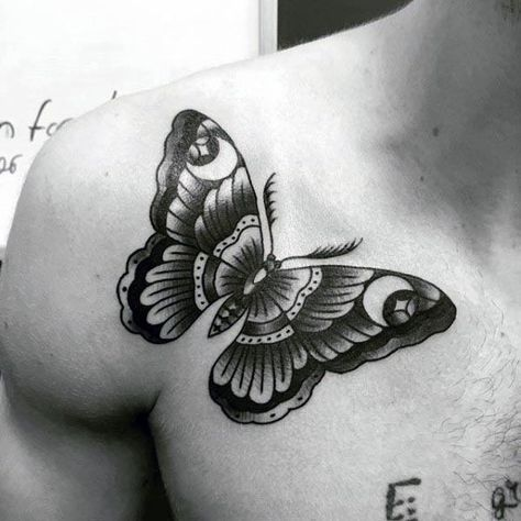large black and grey traditional tattoo on man's shoulder of a dark butterfly