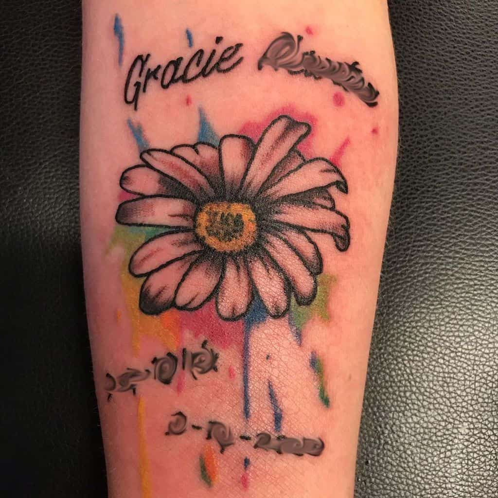 Forearm water color name and dates daisy tribute tattoo