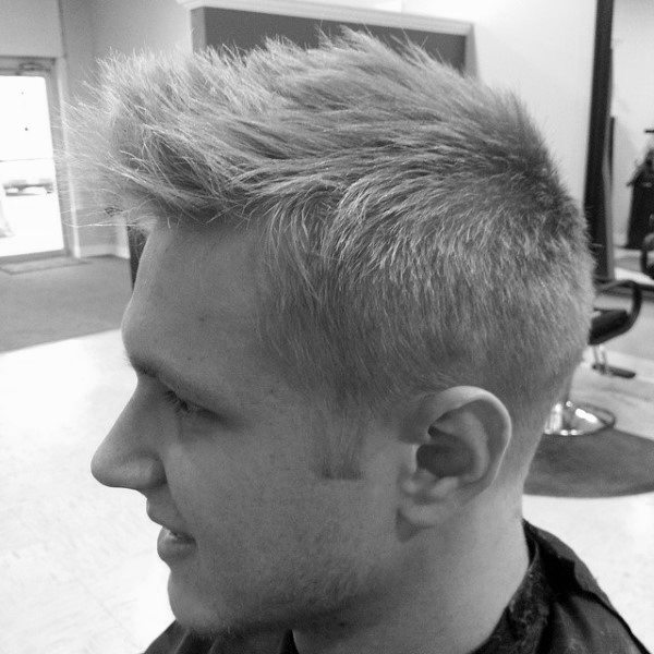 Dapper Low Fade Faux Hawk Hairstyle For Men