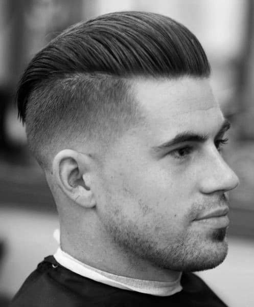 Dapper Male Undercut With Slicked Back Hair On Top