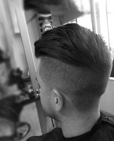 Dapper Slicked Back Undercut Haircut For Males
