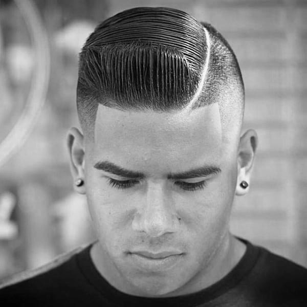 Dapper Slicked Comb Over Fade Haircuts For Males